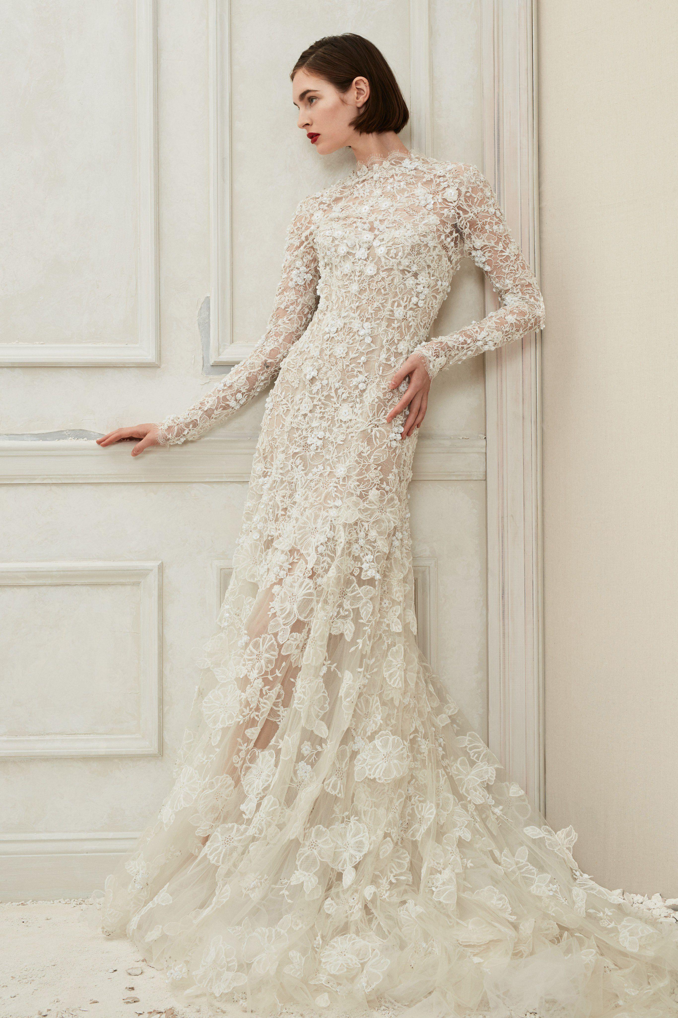 فستان زفاف بنقوش ثابتة حتى الأكمام