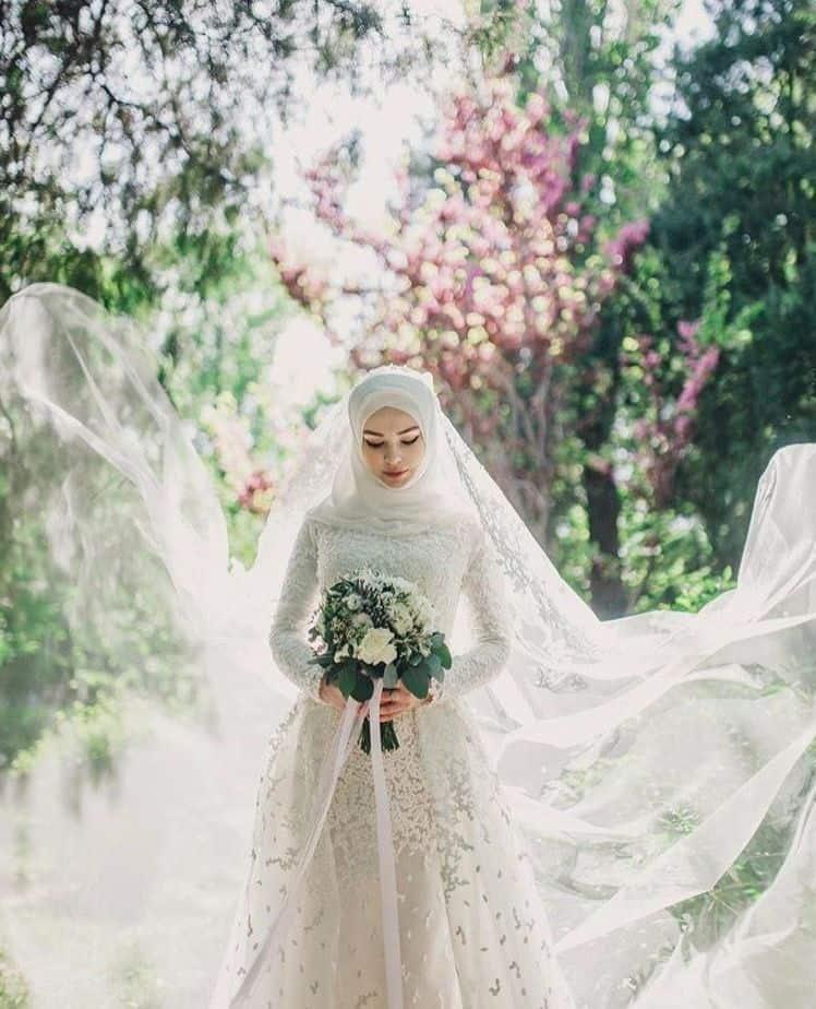 فستان عروس محجبة :فستان بأكثر من طبقة