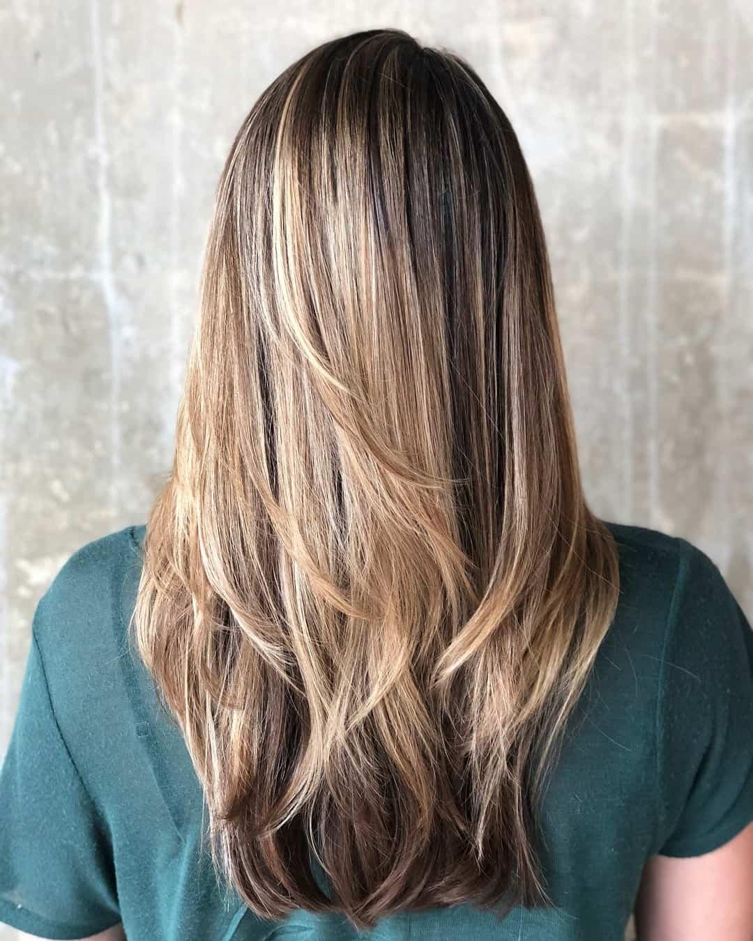 قصات الشعر الطويل وأسمائها : التسريحة الناعمة المنسدلة