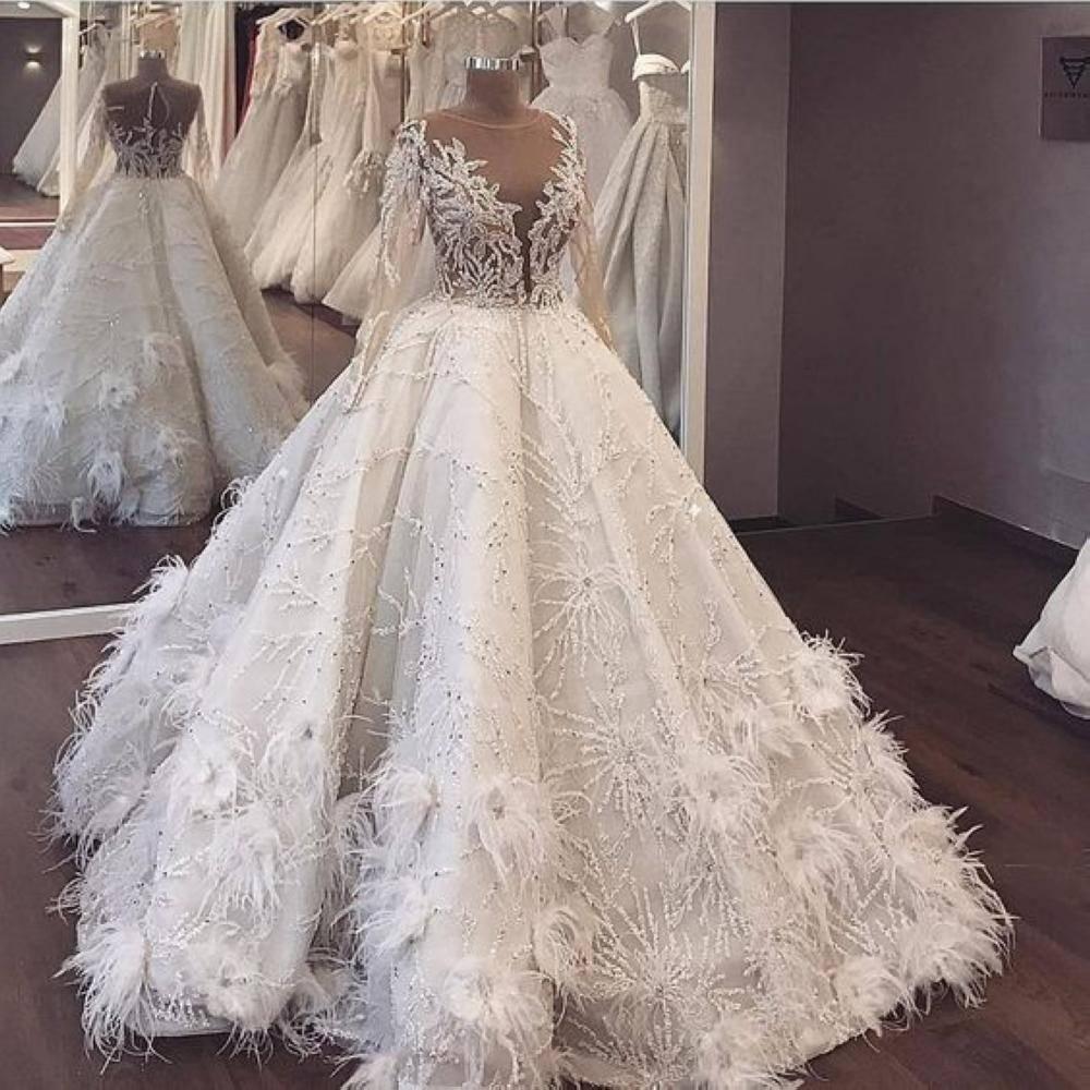 أجمل فساتين الزفاف بالريش عليك اختيار احداها