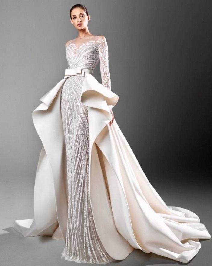 فستان زفاف منسدل بقصة حزام على شكل فيونكة من تصميم زهير مراد.